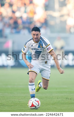 CARSON, CA - OCT 19: Robbie Keane runs the ball down during the Los Angeles Galaxy MLS game against the Seattle Sounders on October 19th 2014 at the StubHub Center. - stock photo