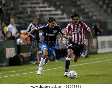 CARSON, CA. - OCTOBER 17: Shea Salinas (L) and Ante Jazic (R) in action during the Chivas USA vs. San Jose Earthquakes match at the Home Depot Center on October 17, 2009 in Carson. - stock photo