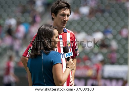 CARSON, CA. - SEPTEMBER 13: Sacha Kljestan interviewed by Amanda Fletcher during half time of the Chivas USA vs. New England Revolution match  at the Home Depot Center on September 13, 2009 in Carson.