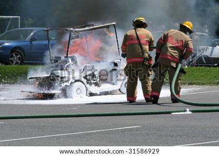 Cart Fire + Firemen - stock photo