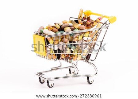 cart with many medical pills as symbol for internet shopping