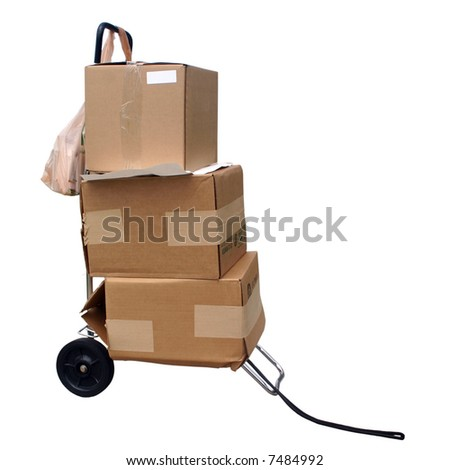 Cart with shipping boxes. - stock photo