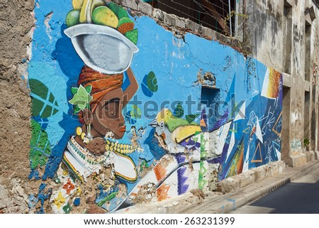 CARTAGENA, COLOMBIA - JANUARY 27, 2015: Colourful murals decorating the walls of a street in the Getsemini area of the historic city of Cartagena in Colombia - stock photo