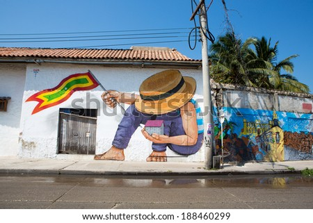 CARTAGENA, COLOMBIA, JANUARY 24 2013: Graffiti in the old streets of Cartagena in Colombia. Made by Jade in 2013. Blue sky in the background. - stock photo