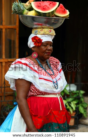 CARTAGENA, COLOMBIA - NOVEMBER 11, 2008: Unidentified woman poses for the artists at the Art and Craft  Market Festival on November 15, 2008 in Cartagena, Colombia - stock photo
