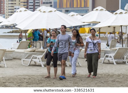 CARTAGENA, COLOMBIA - OCTOBER 29, 2015: Unidentified people on the beach of Cartagena. It is the fifth-largest city in Colombia and the second largest in the region, after Barranquilla.