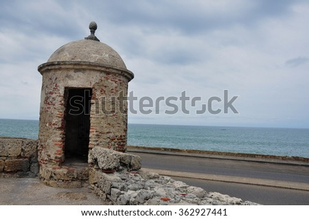 CARTAGENA, COLOMBIA - SEPTEMBER 10, 2014: Sentinel tower at top of the famous wall that surround the downtown and in front of the beach colored