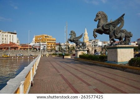 CARTAGENA DE INDIAS, COLOMBIA - JANUARY 29, 2015: Statues of Pegasus on the road leading to the historic Clock Tower and main gateway into the historic walled city of Cateragena de Indias in Colombia - stock photo