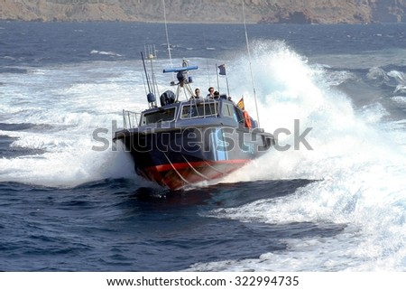 CARTAGENA, SPAIN - SEPTEMBER 24: A coastguard of the Spanish Customs Service makes its patrol along the coast of Cartagena in the Mediterranean province of Murcia, on september 24, 2015 in Cartagena.
