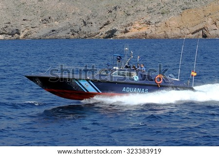 CARTAGENA, SPAIN - SEPTEMBER 24: A coastguard of the Spanish Customs Service makes its patrol along the coast of Cartagena in the Mediterranean province of Murcia, on september 24, 2015 in Cartagena. - stock photo