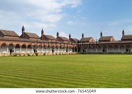 Carterhouse of Pavia, cell complex over a grass field - stock photo