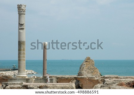 CARTHAGE, TUNISIA - JUNE 18, 2005:Tourists visiting the archaeological remains of the ancient Phoenician city