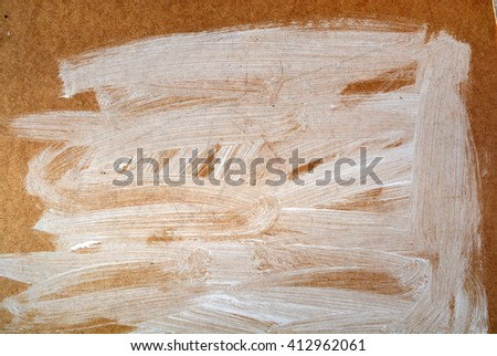 Carton background with expressionistic white paint   - stock photo