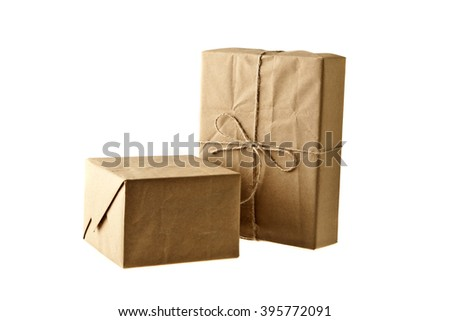 Carton boxes carton wrapped with brown paper and tied with string - stock photo