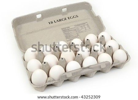 Carton of eggs isolated over white background - stock photo