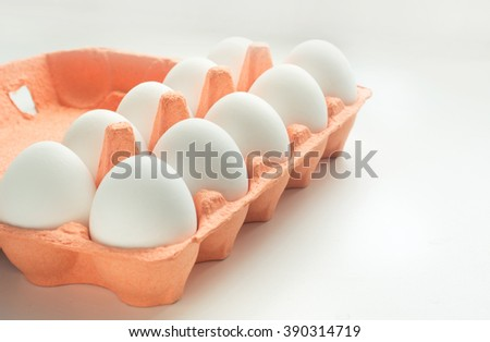 Carton of organic eggs with instant photograph. Selective focus. - stock photo