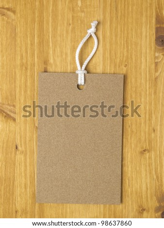 Carton square label on wood background