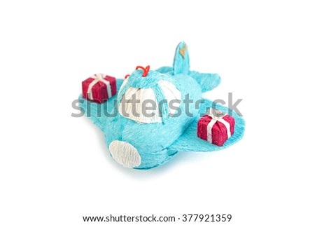 Cartoon cute blue kraft paper Christmas tree toy airplane isolated on white background, with two presents on wings,  with place for your text. Happy birthday for boys. Happy New Year. - stock photo