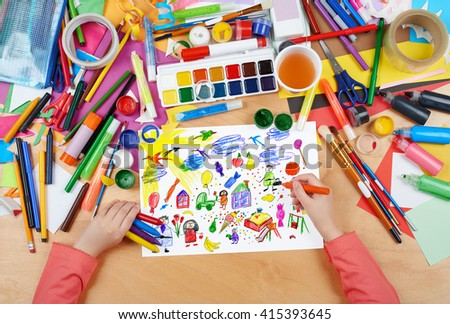cartoon people and funny toy collection,  child drawing, top view hands with pencil painting picture on paper, artwork workplace - stock photo