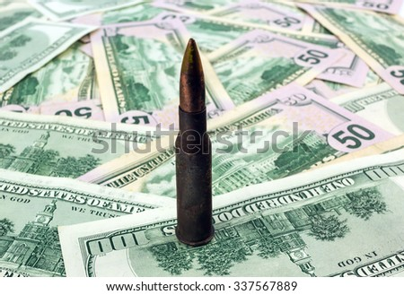 cartridge with a bullet on the hundred dollar bill clouse-up