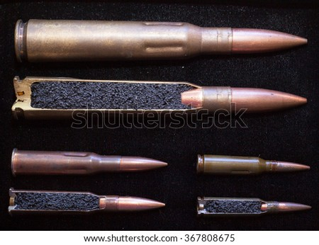 cartridges. bullet. whole and in cross section. - stock photo