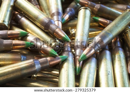 Cartridges designed for a rifle that has bullets with green tips - stock photo