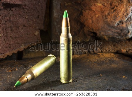 Cartridges for a rifle that have green tipped bullets - stock photo
