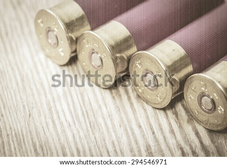 Cartridges hunting ammunition. Old style, sepia - stock photo