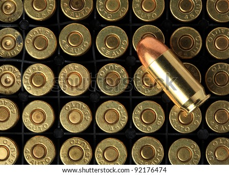 cartridges of .45 ACP pistols ammo. - stock photo