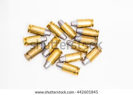 Cartridges of .45 ACP pistols ammo lead bullet on white background - stock photo