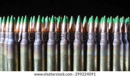 Cartridges that have green tips on the end of their bullets - stock photo