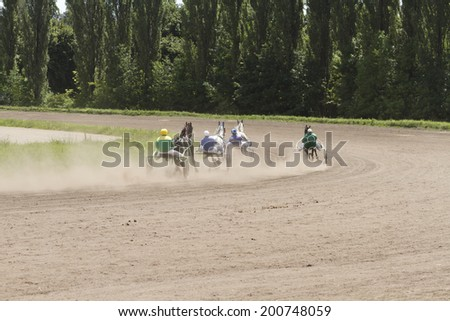 Carts with horses rapidly receding in turn. - stock photo