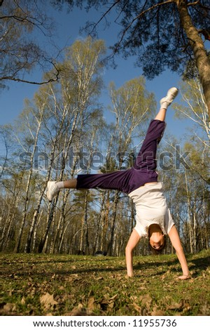 cartwheel in the forest, summer time - stock photo