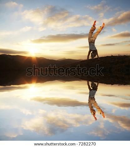 Cartwheel on the sunset - stock photo