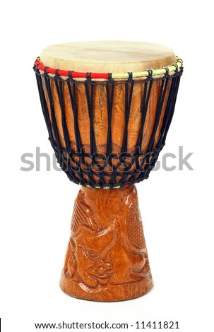 Carved African djembe drum on white background. - stock photo