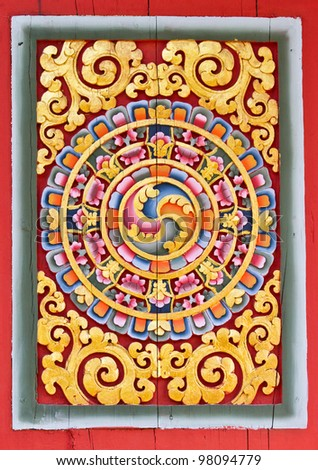 Carved ancient art pattern on door in Thai temple. - stock photo