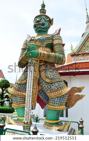 Carved and sculpture giant guardian of Wat Arun ratchawararam Ratchaworamahawihan or Wat Arun location at Chao Phraya Riverside in Bangkok Thailand . One of the most attractive temples in Thailand. - stock photo