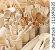 Carved cups, spoons, forks and other utensils of wood - stock photo