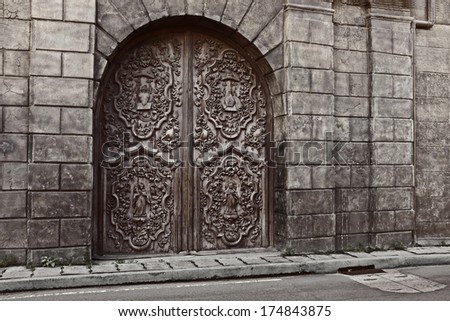 carved doors of san agustin church, intramuros, manila philippines. national historical landmark. designated as world heritage site by unesco.  - stock photo