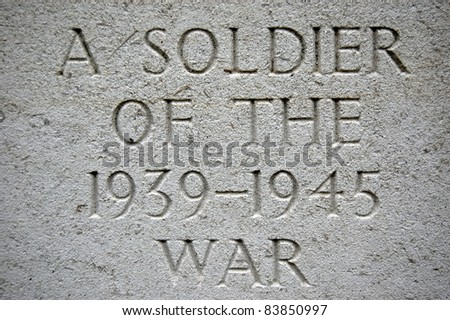 Carved Gravestone Inscription from World War Grave. - stock photo