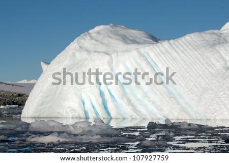 Carved Iceberg in Antarctica - stock photo