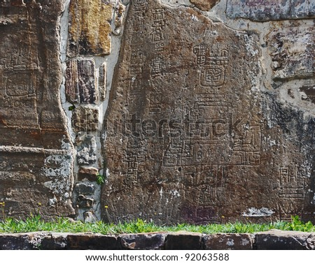 Carved in stone symbols of the mayan calendar on the wall of the Monte Alban, Mexico - stock photo
