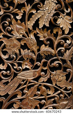 carved on wood - stock photo