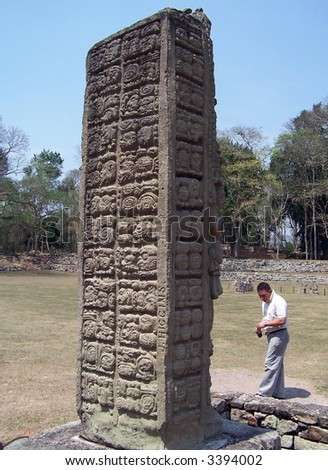 Carved pillar in Copan - ancient city of Maya. UNESCO World Heritage site. Honduras - stock photo