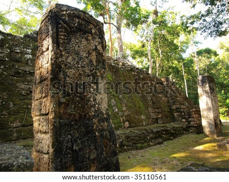 Carved stelae and stone wall at the ancient Mayan ruins of Calakmul, southern Yucatan, Mexico. - stock photo