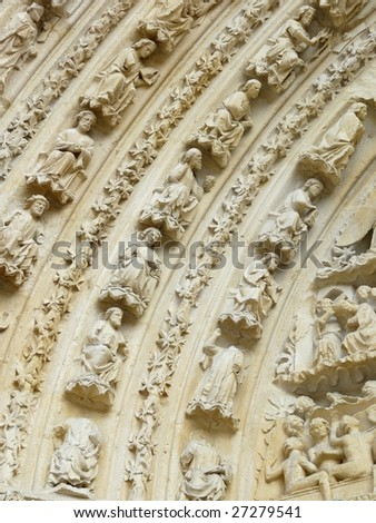 Carved stone lintel on a church door in France