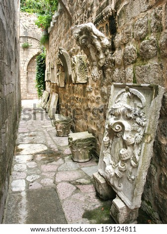 Carved stone tiles on facade - stock photo