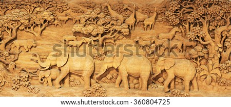 Carved Thai animals on the wood frame on white background,Lions, tigers, elephants, horses, cattle, deer, birds, trees, marking Thailand. - stock photo