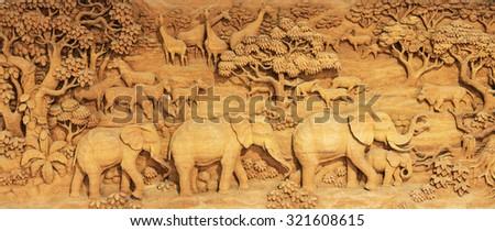 Carved Thai elephant on the wood frame - stock photo