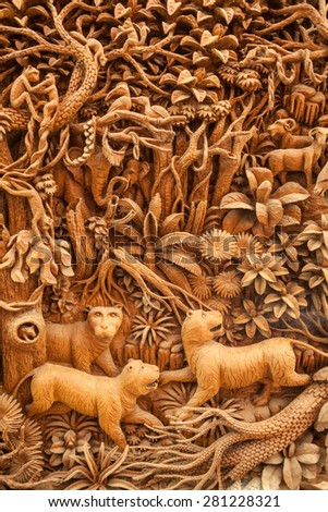 Carved Thai tiger on the wood